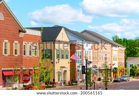 HUDSON, OH - JUNE 14, 2014: Hudson's new retail district, First and Main, was given a retro look to match the quaint charm of the village's original Main Street area one block away. - stock photo