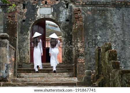 HUE, VIETNAM, MAY 3: Vietnamese girls with Ao Dai in Tu Duc royal tomb on May 3, 2014 in Hue, Vietnam. Ao dai is famous traditional custume for woman in VIetnam.