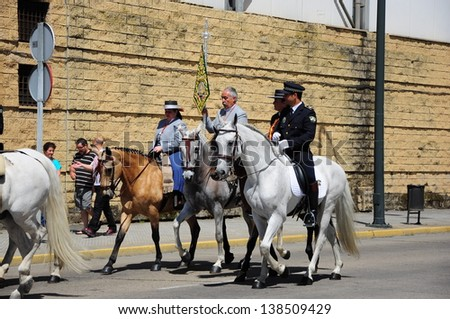 HUELVA, ANDALUSIA, SPAIN - MAY 23: Pilgrims, people with horse in the way to of El Rocio in Andalusia. The pilgrimage, to El Rocio is most popular in the Andalusia on May 23, 2012 in Huelva, Spain