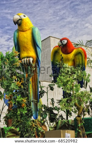 HUELVA  - JANUARY 5: Festivals - Three Kings, View of Parrot birds, outdoor scene, the traditional Kings Day parade, january 5, 2011 in Huelva, Andalusia, Spain. - stock photo