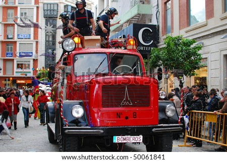 HUELVA - JANUARY 5: Reyes Magos - Three Kings, The traditional parade in street - Antique firefighters truck, january 5, 2010 in Huelva, Andalusia, Spain. - stock photo