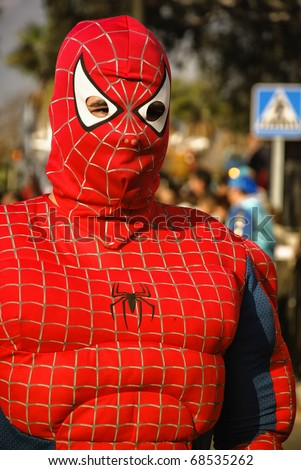 HUELVA - JANUARY 5: Three Kings, View of Spider-Man, the traditional Kings Day parade in street, january 5, 2011 in Huelva, Andalusia, Spain.