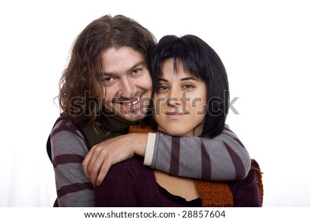 Hug between a young man and pretty woman couple