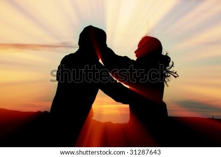 Hug sunset - stock photo