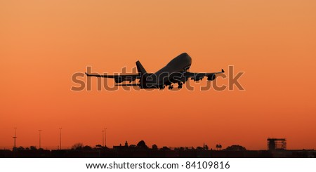 huge airplane departures airport at sunset background orange clear plain sky