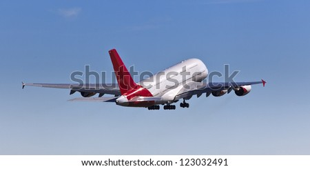 huge airplane taking off at airport departure in the sky blue sky back view of jet - stock photo