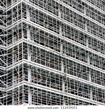 Huge amount of scaffolding in a very large construction site - stock photo