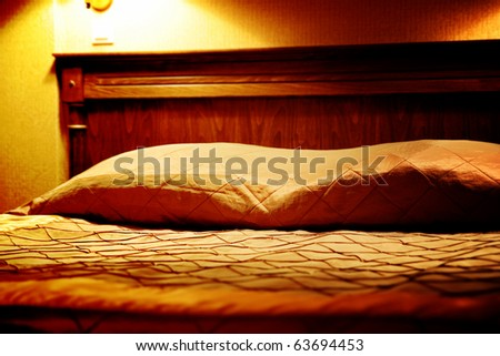 Huge bed in a hotel room. - stock photo