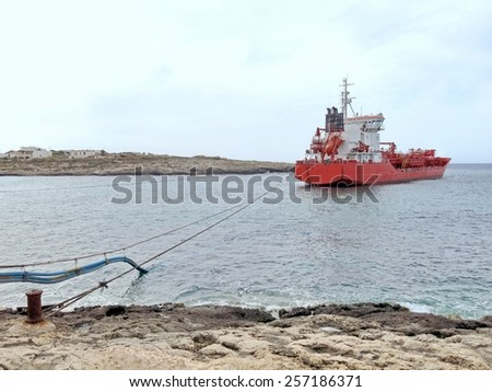 huge boat transport industrial goods and liquids moored in the Bay - stock photo