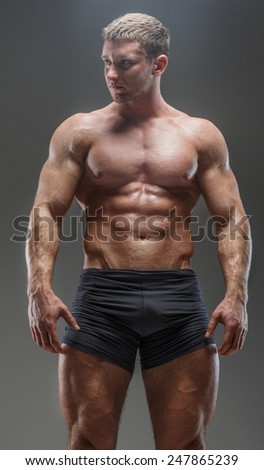 Huge bodybuileder showing his pumped musculed body
