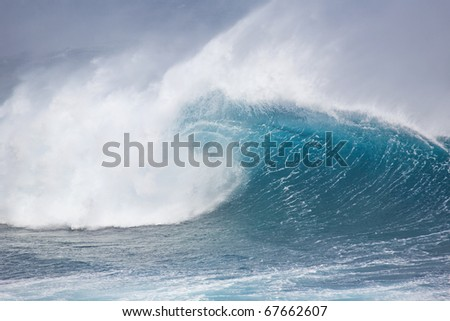 Huge breaking wave with a nice tube. - stock photo