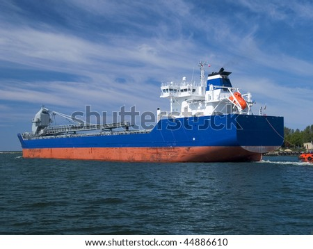 Huge bulk carrier heading for a new port of call - stock photo