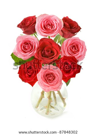 Huge bunch of red and pink roses in vase isolated on white - stock photo