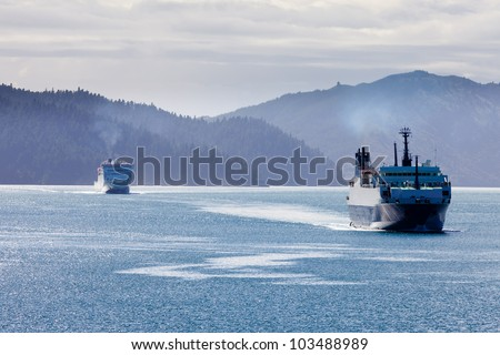 Huge car ferry ships in calm water of Marlborough Sounds, South Island, New Zealand - stock photo