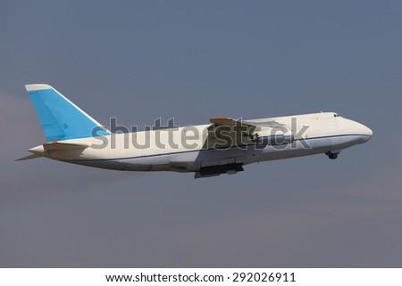 Huge cargo plane on the runway - stock photo