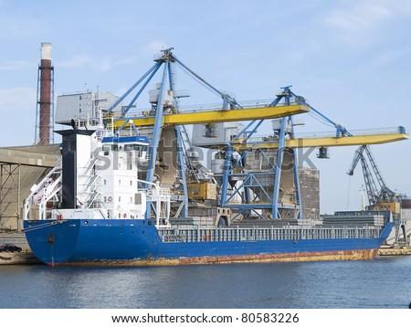 Huge cargo ship at port - stock photo