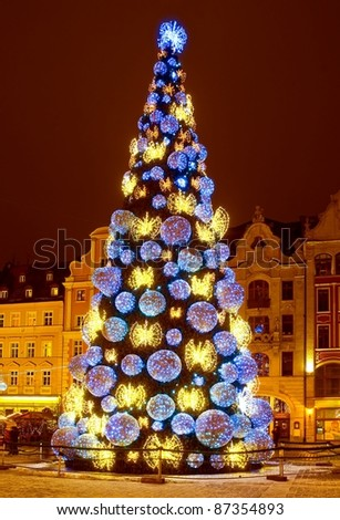 Huge Christmas tree in the city centre - stock photo