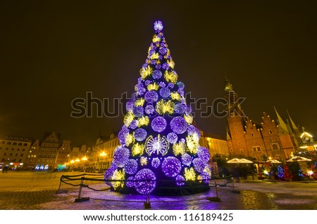 Huge Christmas tree in the city centre at night - Wroclaw, Poland - stock photo