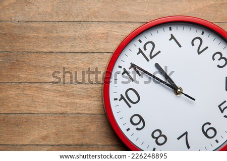 Huge clock on a table. - stock photo