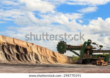 huge coal mining coal machine under cloudy sky - stock photo