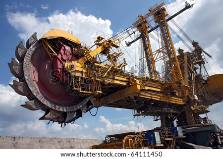 huge coal mining coal machine under cloudy sky - stock photo