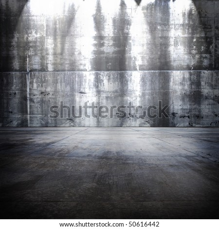Huge concrete room with top light. - stock photo