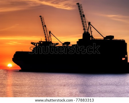 Huge container cargo  ship moored to a wharf - stock photo