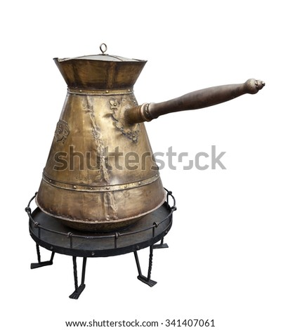 Huge copper Turkish coffee pot isolated on white background - stock photo