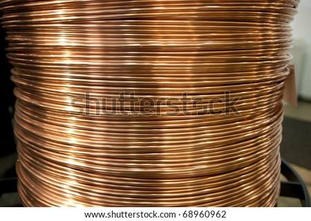Huge copper wire spool for electrical and power industry - stock photo