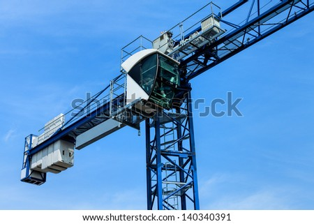 Huge crane on the background of a blue sky