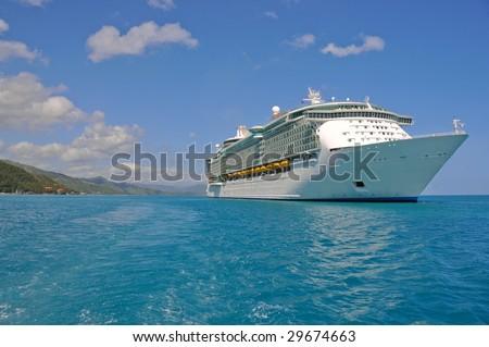 huge cruise ship in caribbean port - stock photo