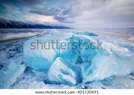 huge cubes of ice on the frozen Lake Baikal - stock photo