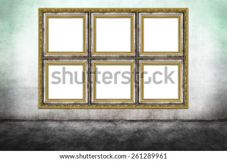 Huge decorated frame on dirty wall . - stock photo