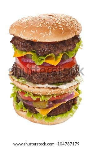 huge double tasty cheeseburger isolated on white background - stock photo