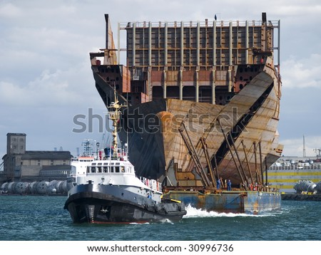 Huge elements of a ship during transport from shipyard - stock photo