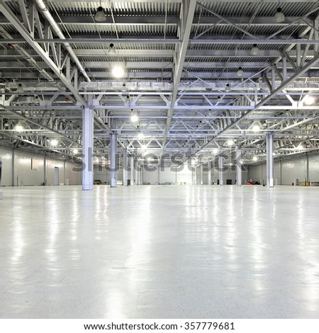 Huge empty storehouse - stock photo