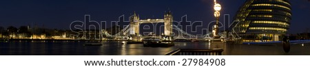 HUGE-Evening panorama of Central London, icluding famous landmarks as Tower bridge, The tower of London, City Hall  and skyscrapers of  Canary Wharf. - stock photo