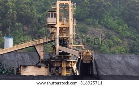 huge excavator of coal in a mine - stock photo