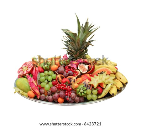 huge exotic fruit platter from buffet isolated on white - stock photo