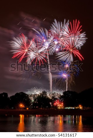 Huge fireworks with reflection in the lake - stock photo