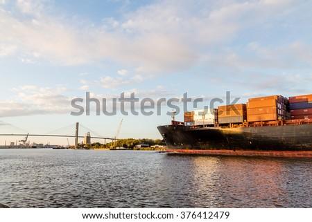 Huge freighter sailing up Savannah River - stock photo