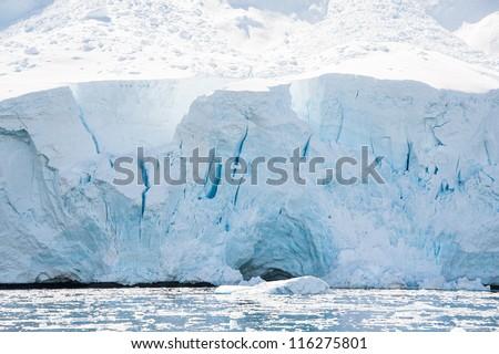 Huge glacier in the  Antarctic waters - stock photo