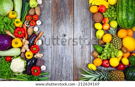 Huge group of fresh vegetables and fruit on wooden background - Vegetables VS Fruit - High quality studio shot - stock photo