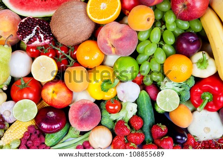 Huge group of fresh vegetables and fruits isolated on a white background. Shot in a studio - stock photo