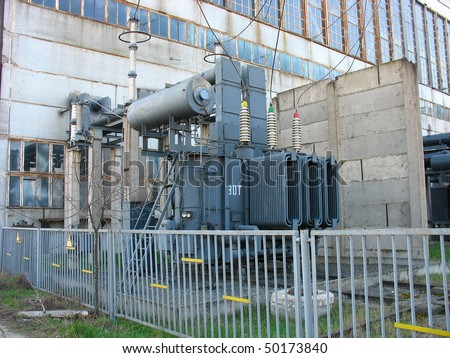 Huge high voltage electric converter at a power plant - stock photo