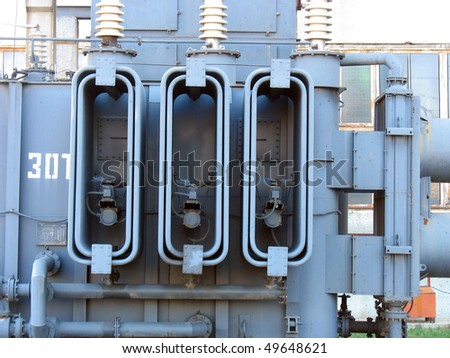 Huge high voltage electric converter detail at a power plant - stock photo