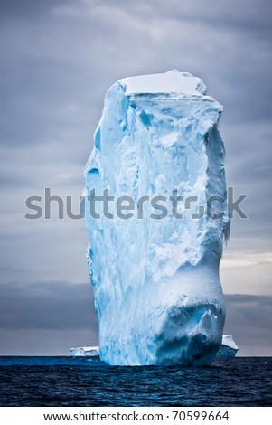 Huge iceberg in Antarctica floating - stock photo