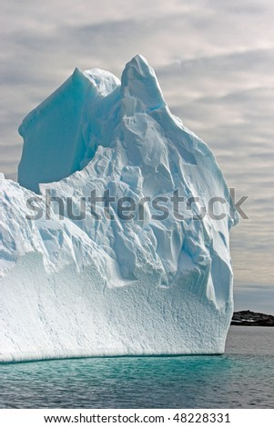 Huge iceberg in sea, Antarctica - stock photo