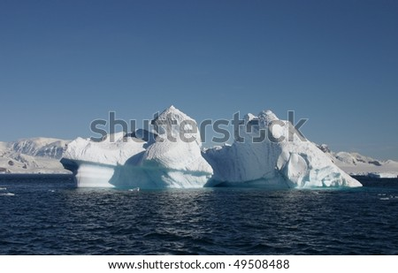 Huge iceberg seen from a sailing boat in Antarctica
