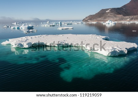 Huge iceberg visible in the water - stock photo